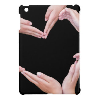 Arms and hands of girls making heart shape iPad mini covers
