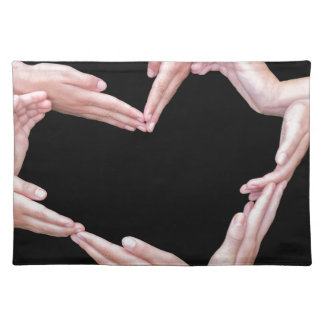 Arms and hands of girls making heart shape placemat