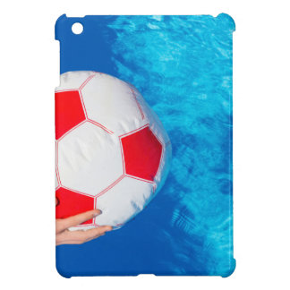 Arms holding beach ball above swimming pool water iPad mini cases