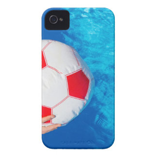 Arms holding beach ball above swimming pool water iPhone 4 cover
