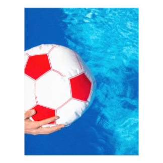Arms holding beach ball above swimming pool water letterhead