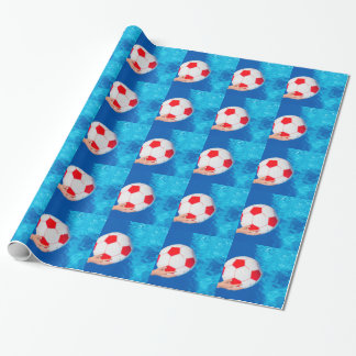 Arms holding beach ball above swimming pool water wrapping paper