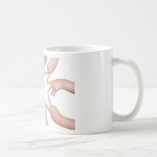 Arms of children  hands making star coffee mug