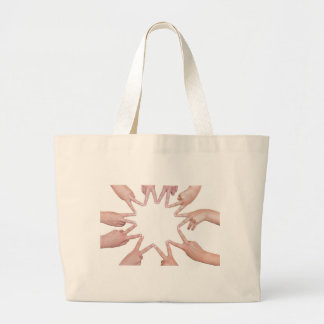 Arms of children  hands making star large tote bag