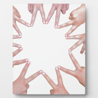 Arms of children  hands making star plaque