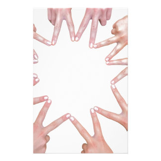 Arms of children  hands making star stationery paper
