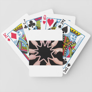 Arms of girls  hands making ten pointed star bicycle playing cards