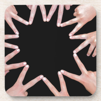 Arms of girls  hands making ten pointed star coaster