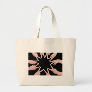 Arms of girls  hands making ten pointed star large tote bag