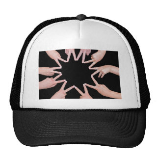 Arms of girls  hands making ten pointed star trucker hat