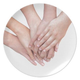 Arms of girls hands on each other plate