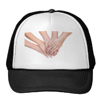 Arms of girls hands on each other trucker hat