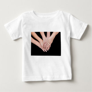Arms of girls with hands over each other baby T-Shirt