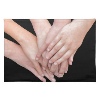 Arms of girls with hands over each other place mats