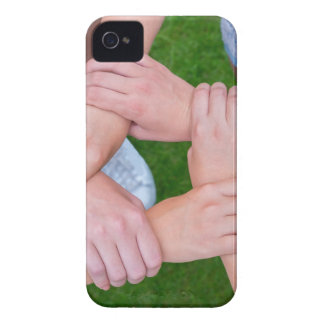Arms with hands of children holding together iPhone 4 cover