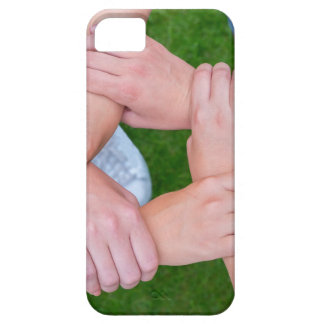 Arms with hands of children holding together iPhone 5 cases