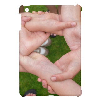 Arms with hands of girls holding each other case for the iPad mini