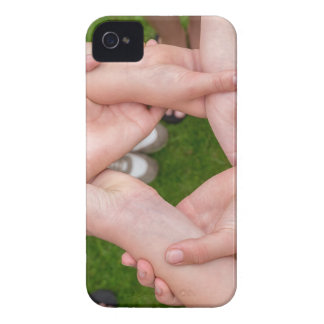 Arms with hands of girls holding each other iPhone 4 cover