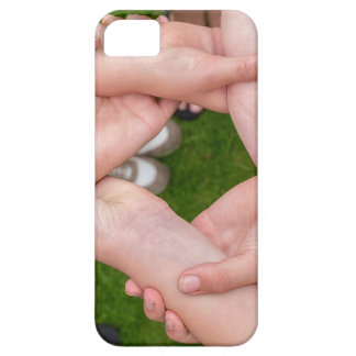 Arms with hands of girls holding each other iPhone 5 covers