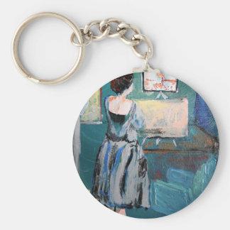 Artiste à son bureau porte-clefs