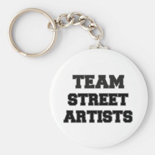 Artistes de rue d'équipe porte-clef