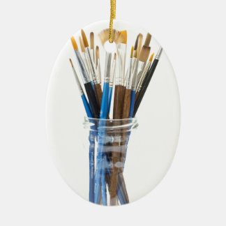 Artists brushes ceramic oval ornament
