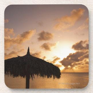 Aruba, silhouette of palapa on beach at sunset beverage coasters