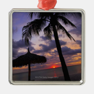 Aruba, silhouette of palm tree and palapa metal ornament