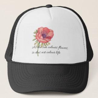As the sun colours flowers trucker hat