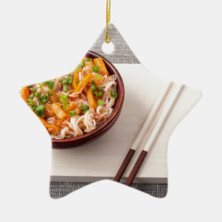 Asian dish of rice noodle and vegetable seasonings ceramic star ornament