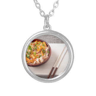Asian dish of rice noodle and vegetable seasonings silver plated necklace