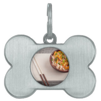 Asian dish of rice noodle in a small wooden bowl pet tag