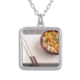 Asian dish of rice noodle in a small wooden bowl silver plated necklace