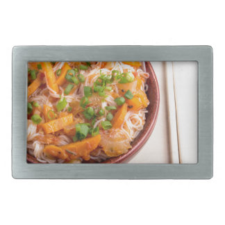 Asian dish of rice noodles in a small wooden bowl belt buckles