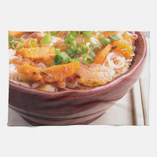 Asian food of rice noodles in a small wooden bowl kitchen towels
