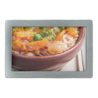 Asian food of rice noodles in a small wooden bowl rectangular belt buckles