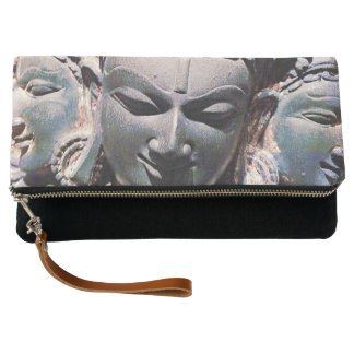 Asian stone face carving photo fold-over clutch