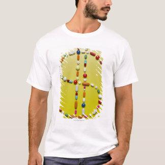 Assorted pills creating dollar symbol T-Shirt