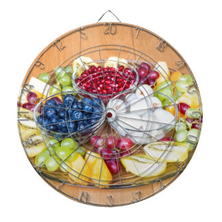 Assortment fresh summer fruit on glass scale dartboard