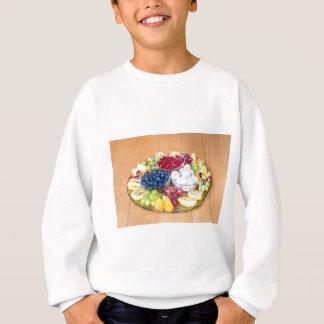 Assortment fresh summer fruit on glass scale sweatshirt