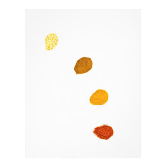 Assortment seasoning spices on porcelain spoons letterhead