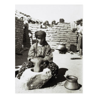 Assyrian refugee pounding bulgur in mortar postcard