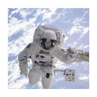 Astronaut Above Earth During Spacewalk Canvas Print