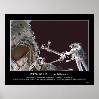 Astronaut Jeffrey N. Williams checks crane Poster