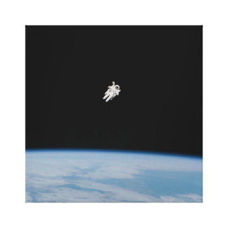 Astronaut Spacewalking Above Earth Canvas Print