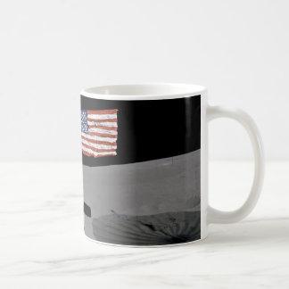 Astronaut stands by the U.S. flag on Moon Coffee Mug