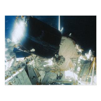 Astronauts Repairing a Satellite in Space Postcard