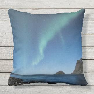 Aurora borealis over night beach throw pillow