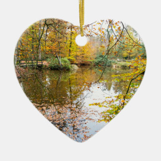 Autumn colors in forest with pond ceramic heart ornament