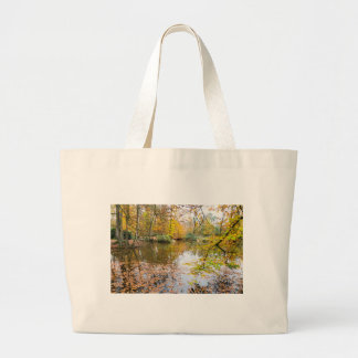 Autumn colors in forest with pond large tote bag